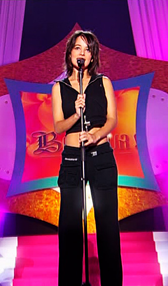 Aliz&eacute;e at Hit machine. Wearing the black outfit.