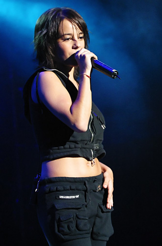 Aliz&eacute;e in South-Korea during her showcase wearing the black ACC outfit.